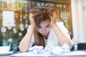 Frustrated woman unable to focus.